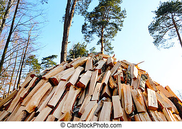 pile of chopped firewood - Pile of chopped pine firewood on...