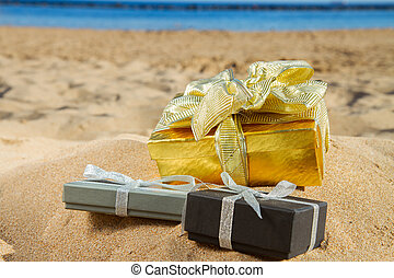 pile of christmas gifts on beach