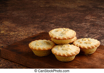 pile of christmas mincemeat pies on wood