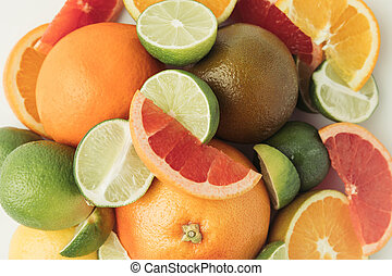 Pile of citruses pieces isolated on white background
