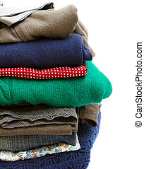 pile of clothes - pile of multicolored clothes on white...