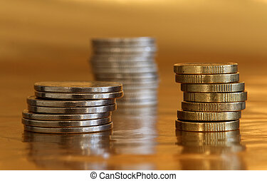 Pile of coins, golden background