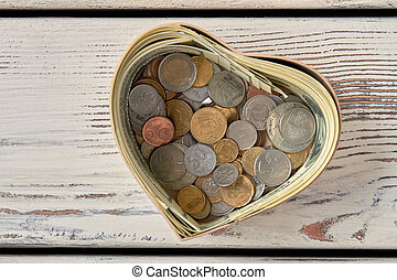 Pile of coins in moneybox.