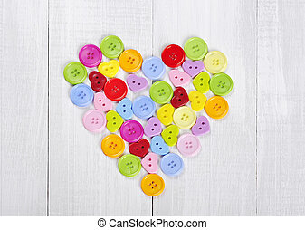 colorful buttons in shape of heart