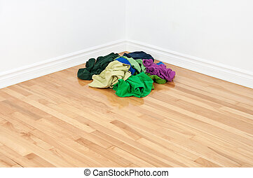 Pile of colorful clothes in the room corner