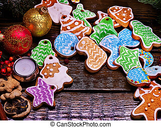 Pile of colorful cookies on a wooden table.