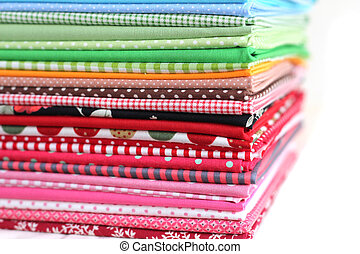 Pile of colorful cotton textile on white background