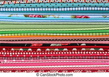 Pile of colorful fabric cotton textile background