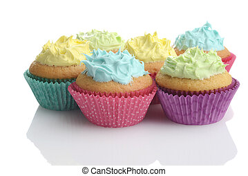 pile of colorful easter cupcakes