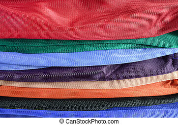 Pile of colorful folded clothes.