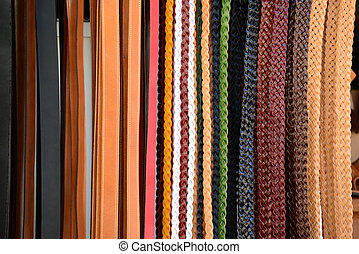 Pile of colorful leather belts