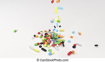 Pile of colorful medicine pills falling on table