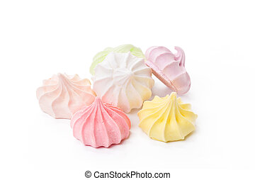 Pile of colorful meringue cookies isolated on white