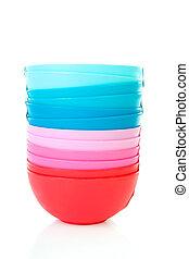 Pile of colorful plastic bowls