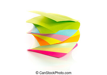Pile of colorful post-it notes stacked on a spiral isolated on white background