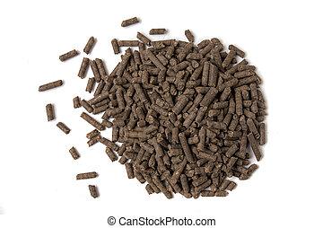 Pile of compressed organic fertilizer.