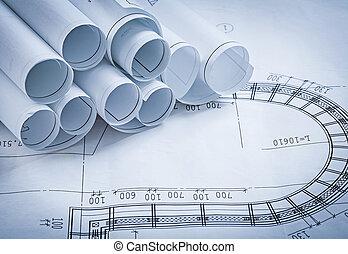 Pile of construction blueprints building and architecture concep