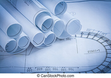 Pile of construction drawings building and architecture concept