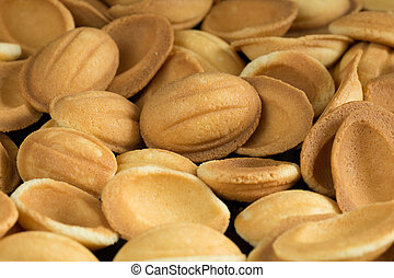 Pile of cookies in walnut form fullscreen