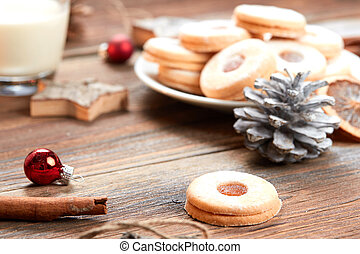 Pile of cookies on white plate on a wooden table