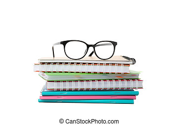 Pile of copybooks and glasses isolated on white background