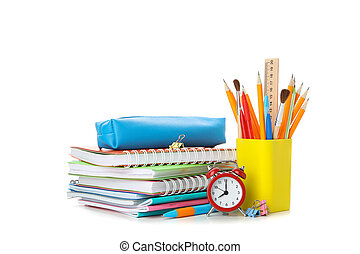 Pile of copybooks and stationery isolated on white background
