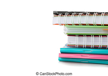 Pile of copybooks isolated on white background