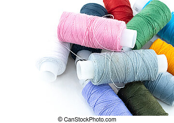 pile of cotton threads multi-colored assorted pink, green and blue