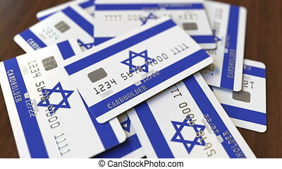 Pile of credit cards with flag of Israel. Israeli banking...