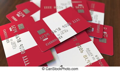 Pile of credit cards with flag of Peru. Peruvian banking...