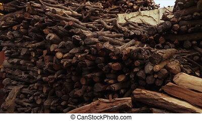 Pile of cremation firewood at Varanasi Ghat, India - Extreme...