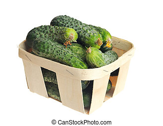 pile of cucumber in a veneer basket isolated