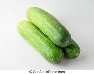pile of cucumbers on white background