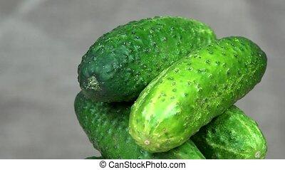 Pile of cucumbers vegetables. Organic food. clockwise...
