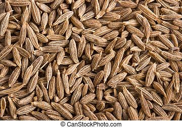 Pile of cumin spice close up