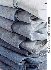 jeans - pile of different shades of blue jeans