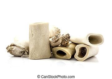 Pile of dog bones isolated on white