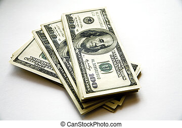 pile of dollar banknotes on a white background