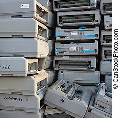 Pile of dot matrix printers on the landfill.