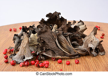 Pile of dried Horn of plenty mushrooms - Pile of dried Horn...