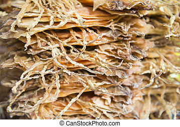 pile of dried squid for sale in market