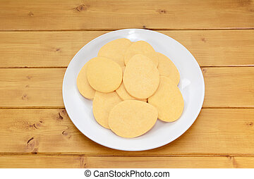 Pile of egg-shaped biscuits on a white plate