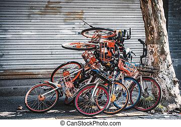 pile of electric bikes on the sidewalk, Hangzhou