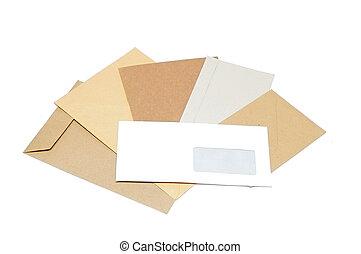 Pile of envelopes on white background