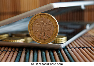 Pile of Euro coins in mirror reflect wallet lies on wooden bamboo table background Denomination is 1 euro - back side