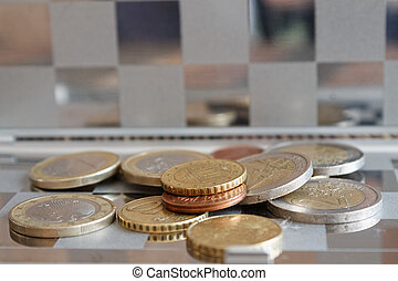 Pile of Euro coins in mirror reflect wallet lies on wooden bamboo table background