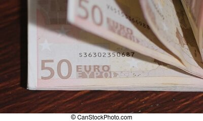Pile of Fifty Euro Banknotes on a Table - A pile of fifty...