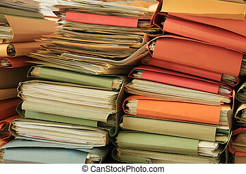 Pile of files - Stacked office files: pile of paperwork in...
