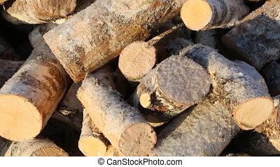 Pile of firewood on snow