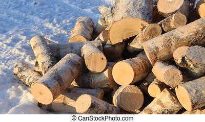 Pile of firewood on snow